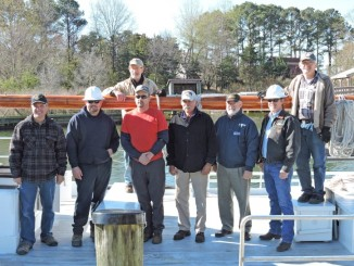 Jim Black, Dee Captain, T.J. Quade, Rigger – Southern MD Crane, Freddy Crouse, Operator – Southern MD Crane, Frank Arbusto, Dee Captain, Doug Alves, CMM Director, Ron Derby, Southern Regional Director – SMECO, George Surgent, CMM Boatwright, Back Row behind boom is John Fulchiron, Dee Mate