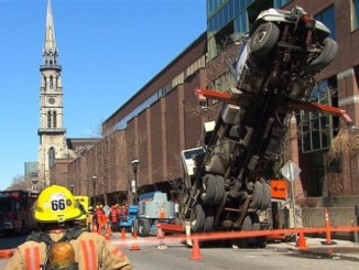 crane-truck-tips-over-st-denis-rene-levesque