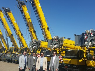From left to right: Staff from Manitowoc and Equipment Co celebrating the sale of 13 new Grove cranes to Arabi Enertech K.S.C.