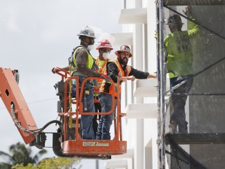 In this Monday, April 11, 2016, photo, construction workers work on a building in Miami Beach, Fla. On Friday, July 1, 2016, the Commerce Department reports on U.S. construction spending in June. (AP Photo/Wilfredo Lee