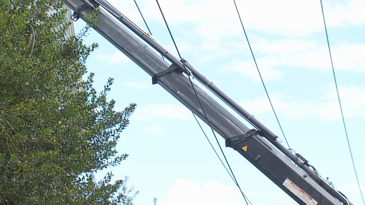 The operator had the boom section telescoping through the power lines