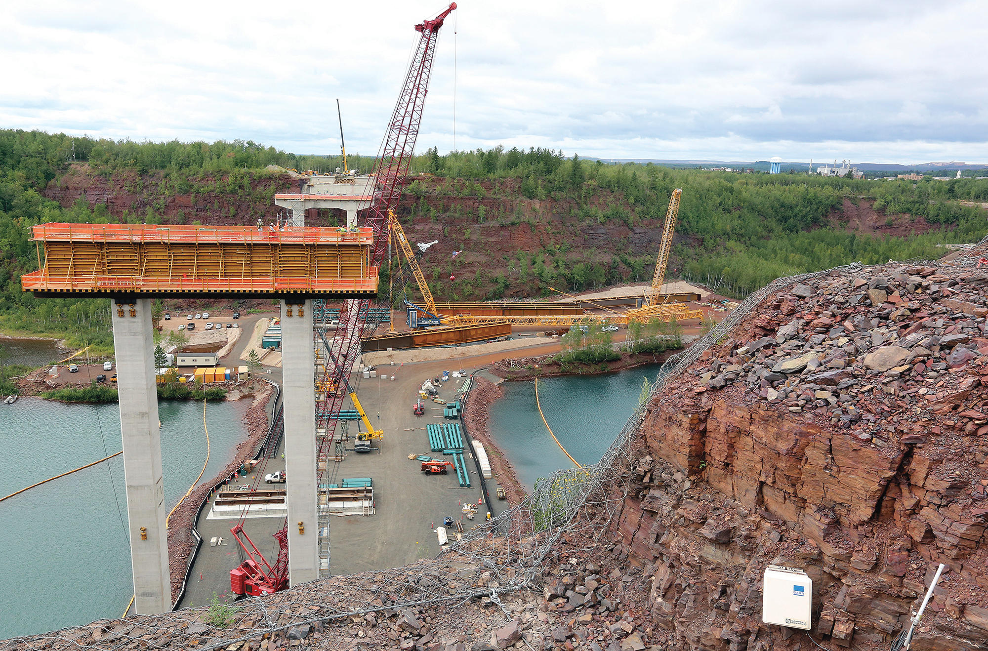 T08.24.2016 -- Steve Kuchera -- kucheraBRIDGE0827c1 -- Work is moving along on the U.S. Highway 53 Bridge over the Rouchleau pit in Virginia. Both piers are finished, with the east pier (foreground) raising 185 feet above the water. Workers will begin raising the bridge's beams next month. Steve Kuchera / skuchera@duluthnews.com