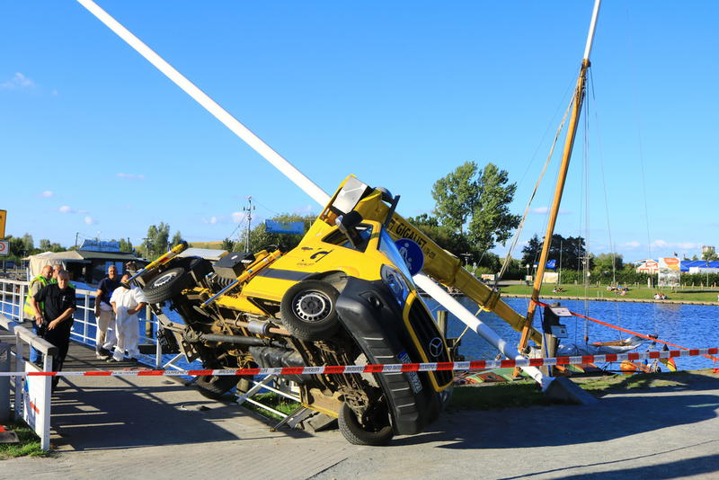 A Straight boom truck mounted aerial lift tipped over in Germany.