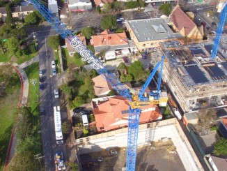 The Raimondi LR165 luffing crane freestanding at 42 meters positioned at residential Melbourne project by Clark Cranes