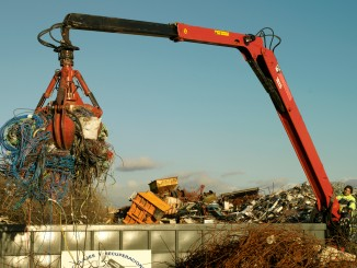 Shown: A Jonsered 1820 Material Handling Recycling Crane