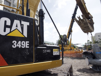 A CAT 349E L excavator on a construction site in Miami Beach Florida.