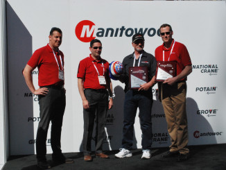 Bronson Crane is the first North American equipment distributor to purchase Potain's new Hup 40-30 self-erecting tower crane, a milestone which was just celebrated at the Manitowoc Cranes booth at CONEXPO 2017. Key staff members from Manitowoc presented the Salt Lake City-based company with a commemorative plaque and a limited edition, hand-painted hard hat to commemorate the occasion, and a champagne toast followed soon after. An additional plaque was also made in honor of Bronson's heavy investment in the Potain brand—from 2014 to 2016, the company purchased more cranes than any other Potain distributor in the U.S.