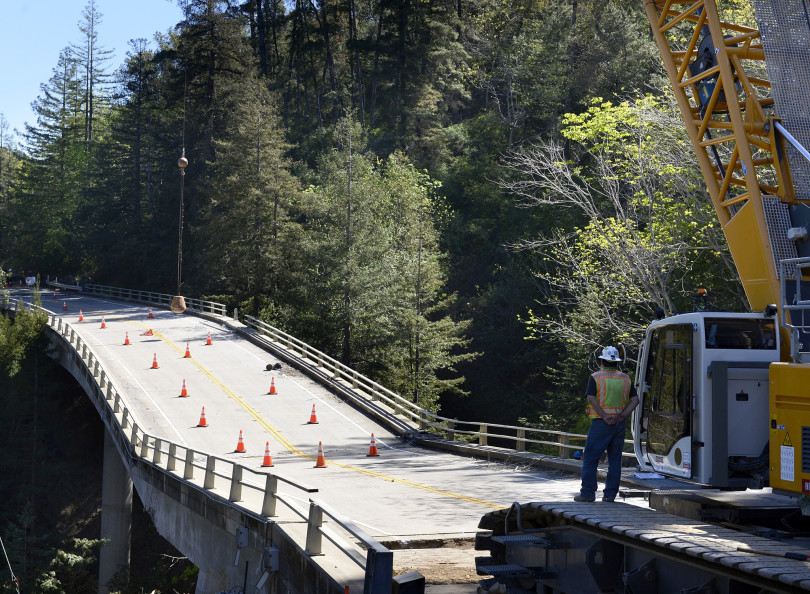 Construction crews use a wrecking ball to dismantle the Pfeiffer Canyon Bridge on Highway 1 in Big Sur, Calif. on Monday March 15, 2017. The bridge was compromised after slides occurred in the area associated with this winter's heavy rains. (David Royal - Monterey Herald)