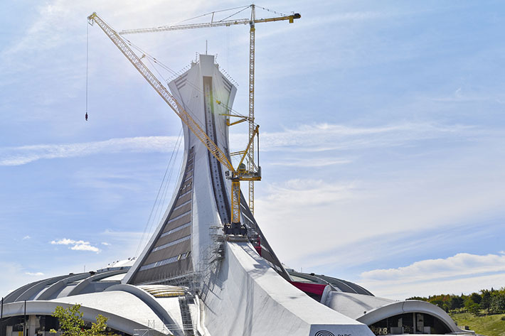 Montréal: Liebherr tower cranes stand above entrance into the Olympic Stadium