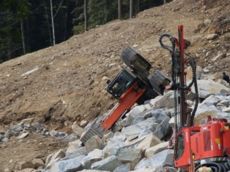 Police said this excavator accidentally tipped over at the top of a steep slope. (Ryan Stelting)