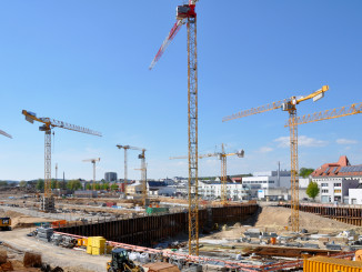 "A fleet of 13 Potain tower cranes is helping to build a new residential and commercial district in Regensburg, Germany. The new district, named ""Das DÖRNBERG,"" is only miles from Regenburg's historic old town, which has been a UNESCO World Cultural Heritage since 2006."