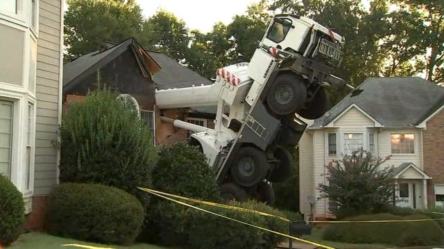 Southway Crane & Rigging cranes called in to upright a Liebherr crane that tipped over on a house near Atlanta, GA