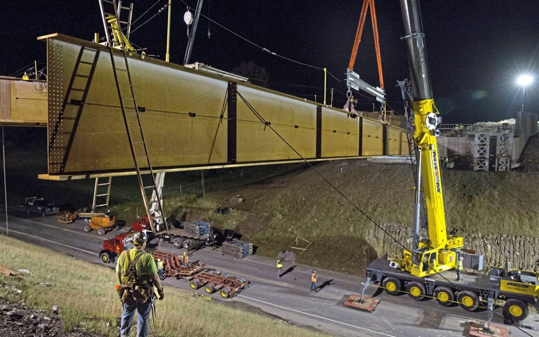 Maxim Crane lifts 150′ bridge beam for the $700m Southern Beltway Bridge Project.