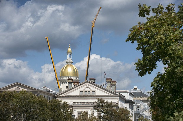 New Jersey's shiny golden dome flanked by two All Terrain Crane in Gov. Chris Christie's $300M Statehouse renovation project.