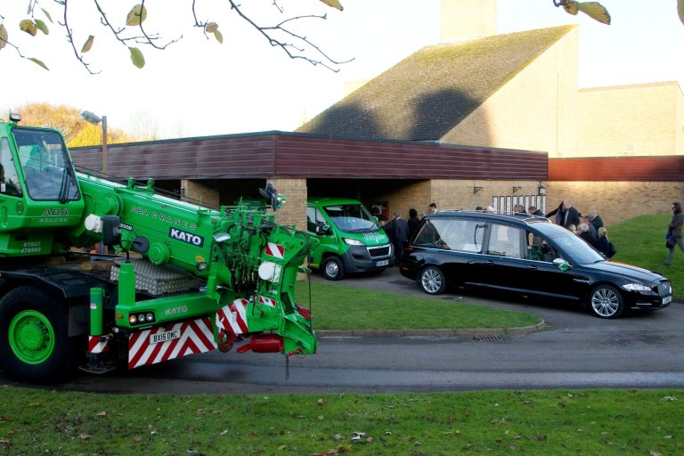 Ben Lawton's funeral at Streetly Crematorium, Walsall, West Midlands. November 8, 2017. ABA Crane Hire pay tribute to a 'much-loved' crane fanatic Ben Lawton aged 35 by following the funeral procession with three giant cranes. Ben would stand at the gates of ABA Crane Hire in Walsall every morning and evening to greet the drivers. Ben who had severe learning difficulties died in October after an unknown illness.