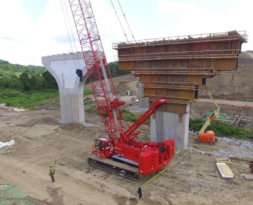 Mosites Construction & Development Company (Mosites) is working on a $93 million infrastructure project that will add seven new bridges along four miles of highway on the Pennsylvania Turnpike near Pittsburgh. The pier caps of the first bridge have already been completed, and two Manitowoc cranes – a Manitowoc MLC165-1 and a Grove GHC75 – were crucial to the success of the project.