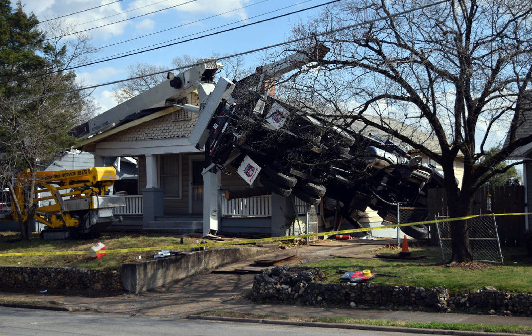 Chattanooga Tree Service Boom Truck topples over last Friday