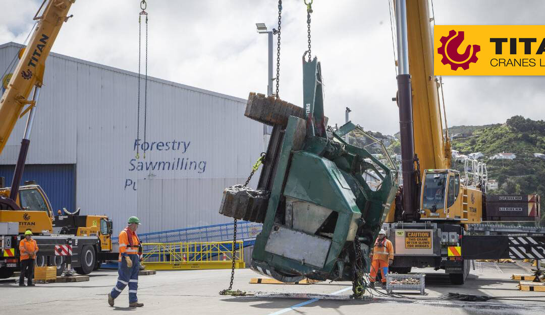 Titan Cranes Limited Liebherr LTM 1350-6.1 lifts 25-ton crawler crane out of Wellington Harbor in New Zealand